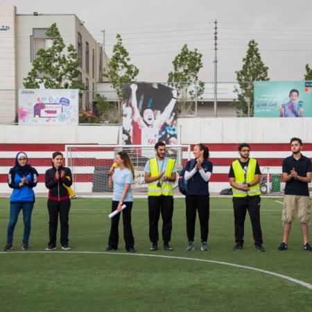 Celebrating the winners of a girls' soccer match in Jordan