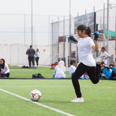 Preparing for a big shot: girls playing soccer in Jordan