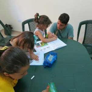 Children learn to read and write literacy in the project