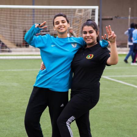 Having fun at the soccer field: two girls in Jordan