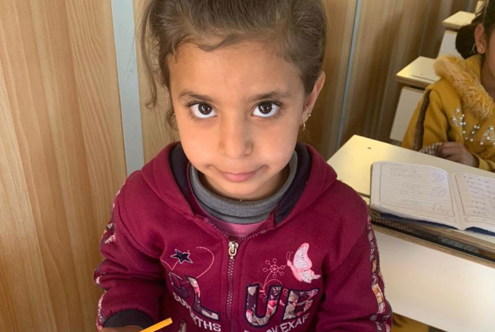 Refugees in Jordan - Clara is learning write and read