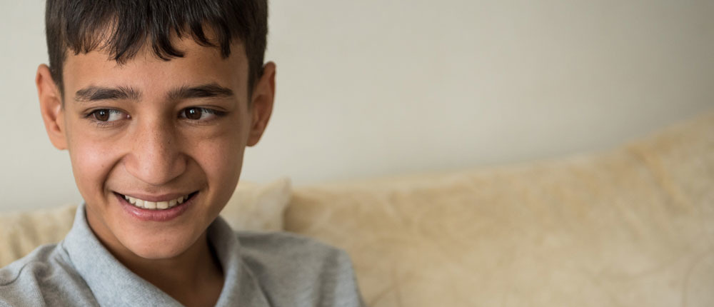 Refugees in turkey - Inclusion and education - a boy smile